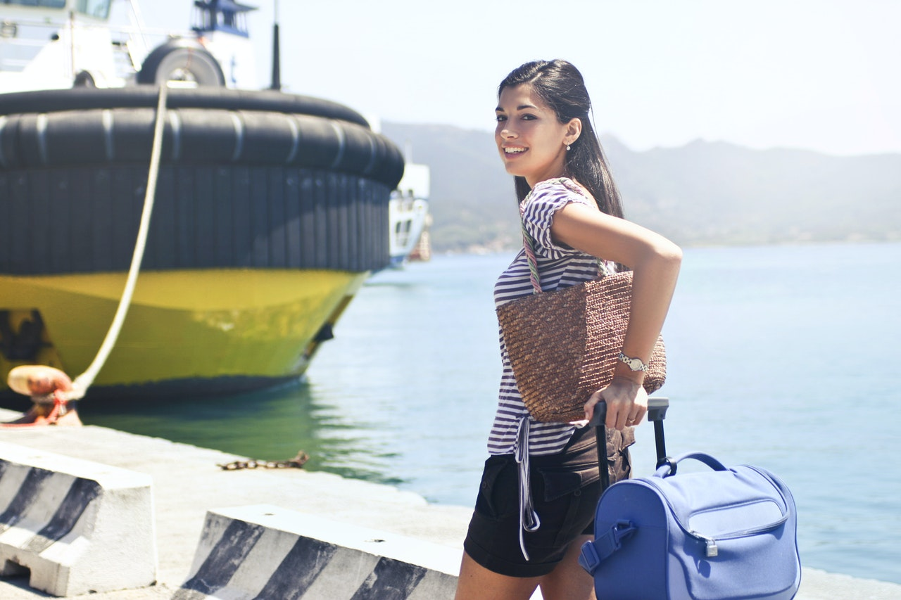 woman with packed luggage on a cruise