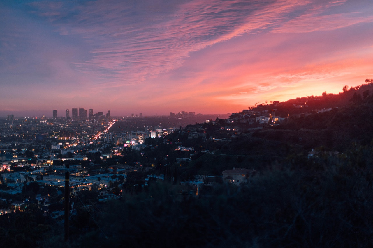 view on the city from hill during sunset