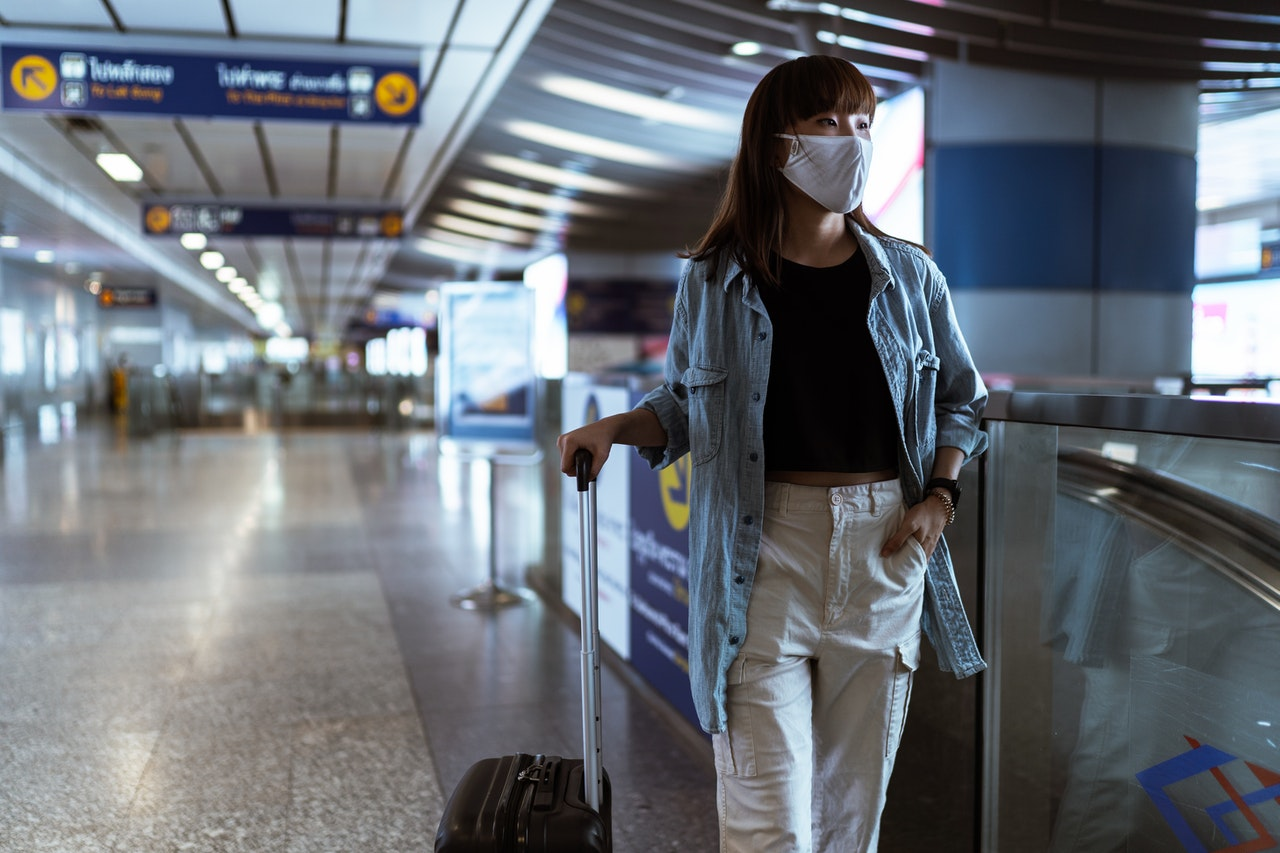 woman on airport with hand luggage